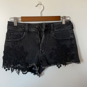 Black jean shorts with lace detail